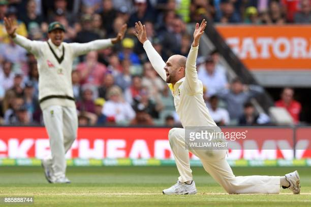 TOPSHOT Australia's spinner Nathan Lyon appeals successfully for an LBW decision against England's batsman Alastair Cook on the fourth day of the...