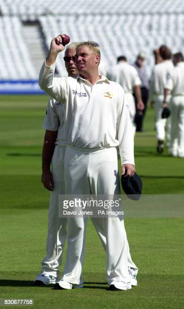 Australia's spinner Shane Warne with teammate Colin Miller during a practice session in the nets at Edgbaston Birmingham
