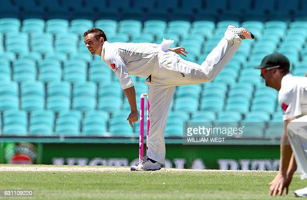 Australia's spinner Steve O'Keefe sends do a delivery to the Pakistan batsman on the final day of the third cricket Test match at the SCG in Sydney...