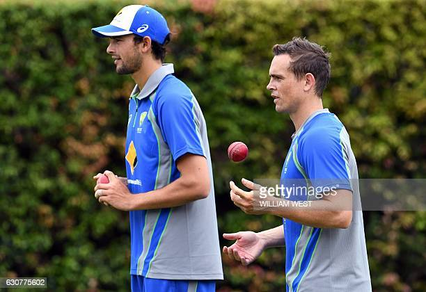 Australia's spinners Ashton Agar and Steve O'Keefe prepare to bowl during cricket training at the SCG in Sydney on January 2 2017 Australia take on...