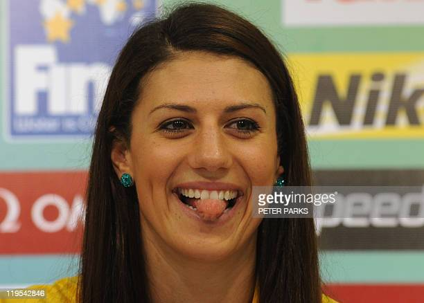 Australia's Stephanie Rice sticks out her tounge during a press conference given by members of the Australian swimming team during the FINA World...