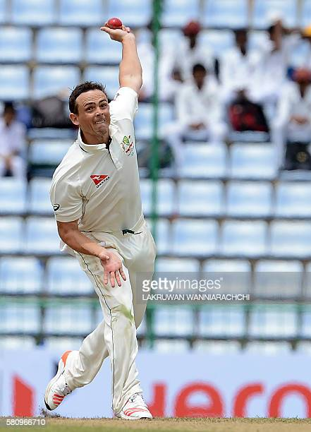 Australia's Stephen O'Keefe delivers the ball during the first day of the opening Test cricket match between Sri Lanka and Australia at The Pallekele...