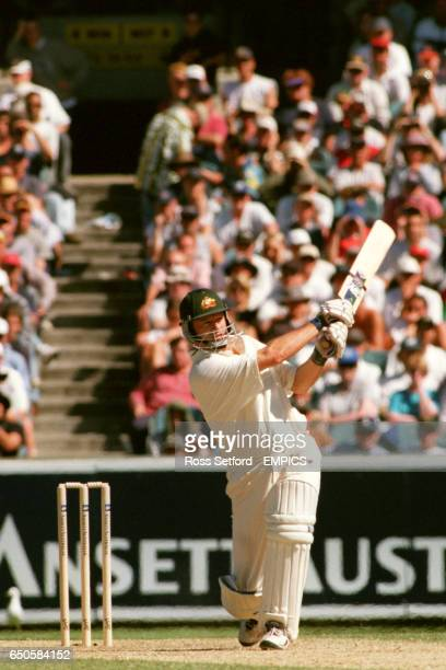 Australia's Steve Waugh drives to the boundary on his way to a century against Australia