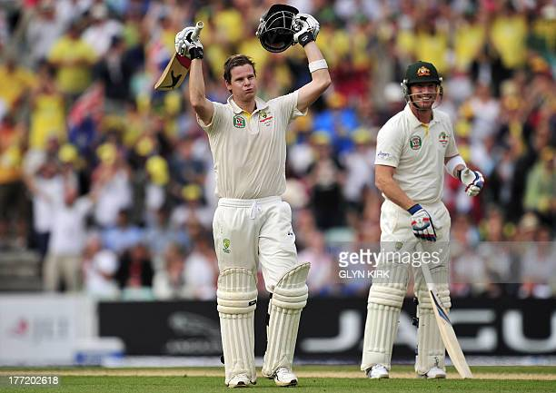 Australia's Steven Smith celebrates reaching his century during play on the second day of the fifth Ashes cricket test match between England and...