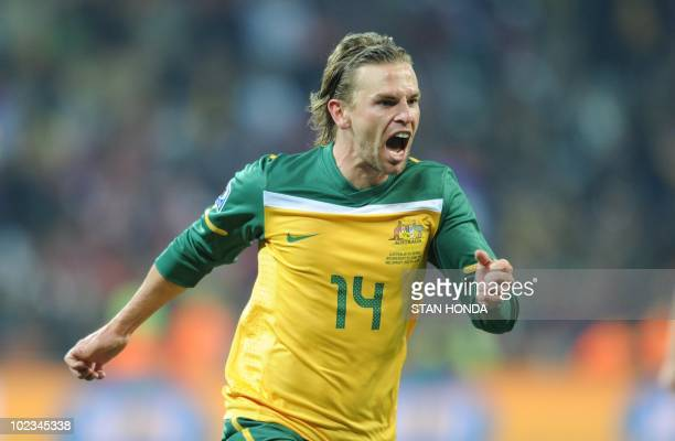 Australia's striker Brett Holman celebrates after scoring during the Group D first round 2010 World Cup football match Australia vs Serbia on June 23...