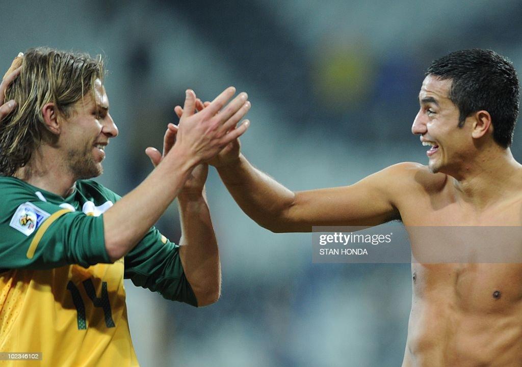 Australia's striker Tim Cahill jokes with Australia's striker Brett Holman at the end of the Group D first round 2010 World Cup football match...