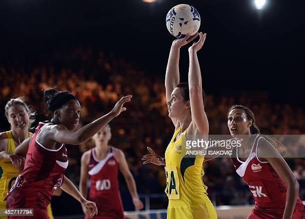 Australia's Tegan Caldwell prepares to shoot the ball past England's Geva Mentor and Eboni BeckfordChambers during a Netball Group B Preliminary...