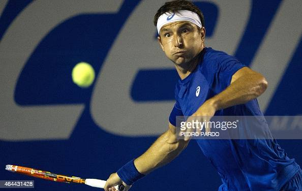 Australia's tennis player Marinko Matosevic returns the ball to David Ferrer of Spain during the Mexico ATP tournament in Acapulco Guerrero State on...