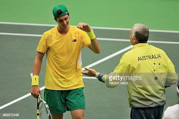 Australia's Thanasi Kokkinakis celebrates during the first round tennis match of the Davis Cup Australia vs Czech Republic on March 6 2015 in Ostrava...