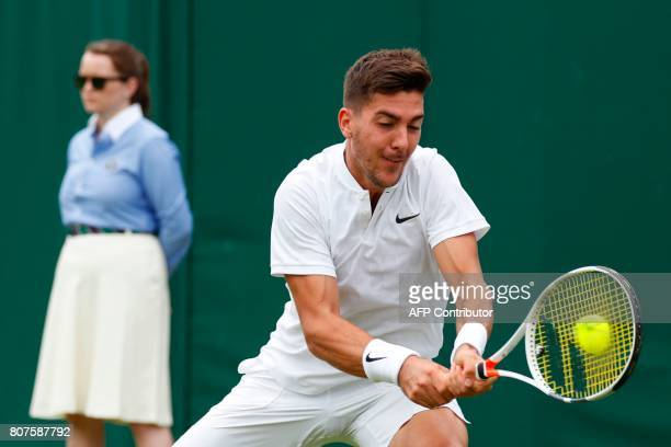 Australia's Thanasi Kokkinakis returns against Argentina's Juan Martin del Potro during their men's singles first round match on the second day of...