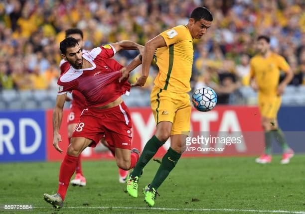 Australia's Tim Cahill fights for the ball with Syria's Mahmoud Almawas as Australia defeats Syria in their 2018 World Cup football qualifying match...