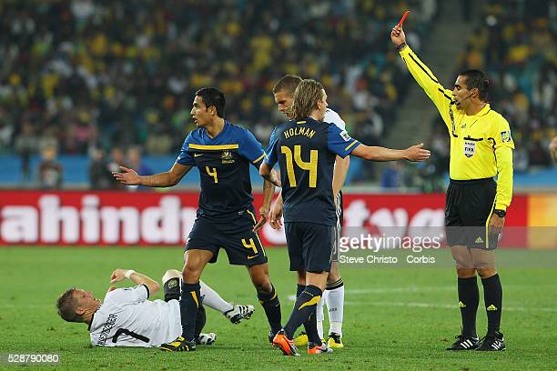 Australia's Tim Cahill is awarded a red card by referee Marco Antonio Rodr����guez Moreno after his tackle on Germany's Bastian Schweinsteiger at...
