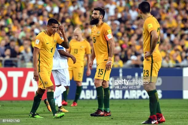 Australia's Tim Cahill Mile Jedinak and Tom Rogic react during their 2018 World Cup qualification playoff football match against Honduras at Stadium...