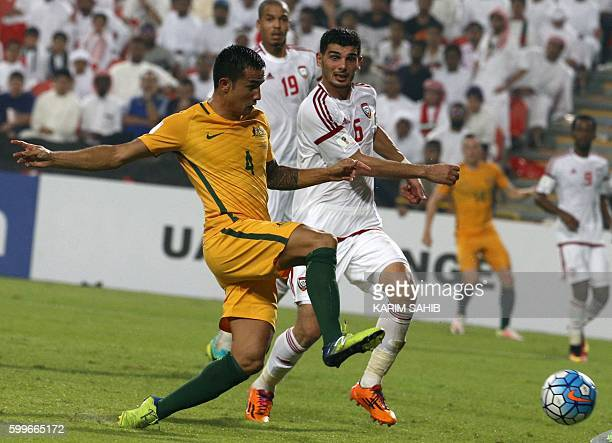 Australia's Tim Cahill vies with UAE's Mohnad Salem during their World Cup 2018 Asia qualifying football match United Arab Emirates versus Australia...
