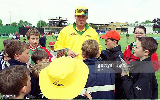 Australia's Tom Moody proves a hit with the autograph hunters before the cancelled match Glamorgan vs Australia at Cardiff 08 May 1999 AFP PHOTO