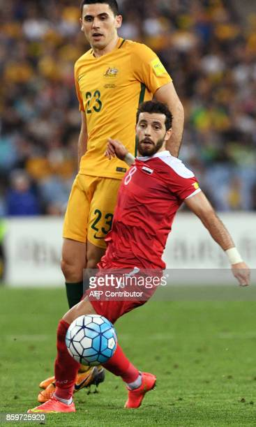 Australia's Tomas Rogic fights for the ball with Syria's Mahmoud Almawas as Australia defeats Syria in their 2018 World Cup football qualifying match...