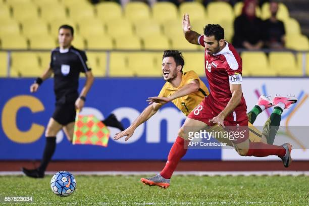Australia's Tomi Juric and Syria's Zaher Almedani compete for the ball during the 2018 World Cup qualifying football match between Syria and...