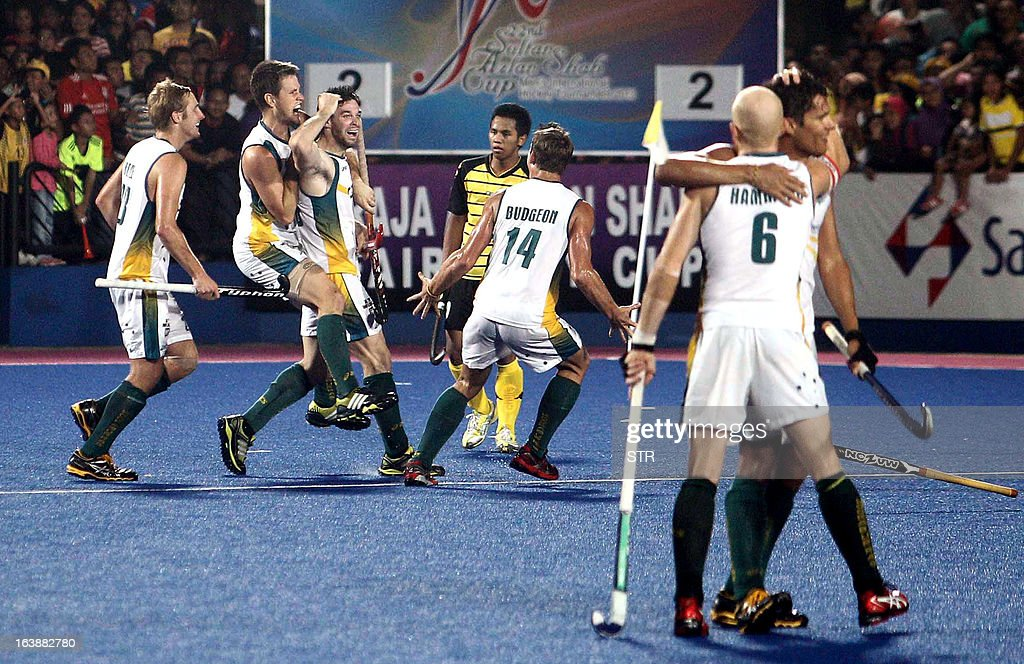 Australia's Trent Mitton (3L) celebrates with teammates after scoring the winning goal against Malaysia during the Sultan Azlan Shah Cup men's field hockey tournament finals in Ipoh, Malaysia's northern Perak state, on March 17, 2013. Australia defeated Malaysia by 3-2. AFP PHOTO