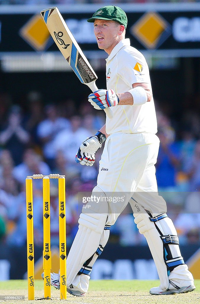 Australia's vice captain Brad Haddin salutes to the crowd after reaching a half century on day one of the first Ashes cricket Test match between England and Australia at the Gabba Cricket Ground in Brisbane on November 21, 2013. AFP PHOTO / Patrick Hamilton USE
