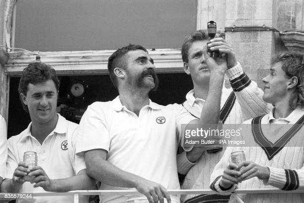 Australia's victorious cricketers celebrate after winning the sixth and final Cornhill Test and the series at the Oval From left Tim May Merv Hughes...