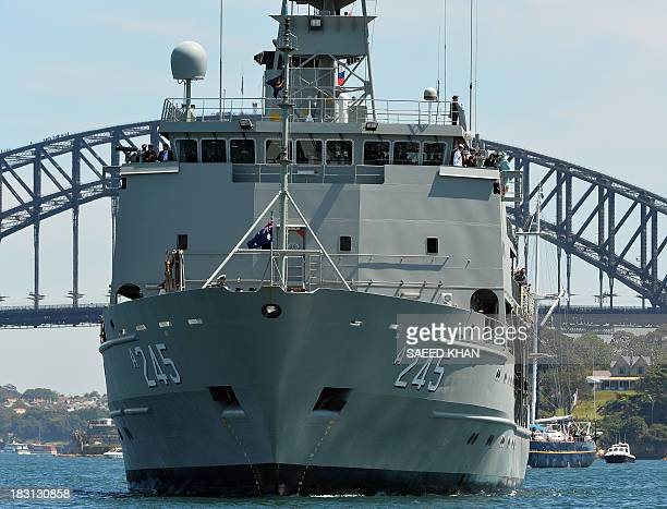 Australia's warship HMAS Leeuwin carrying Britain's Prince Harry Australian Prime Minister Tony Abbott and GovernorGeneral Quentin Bryce sails during...