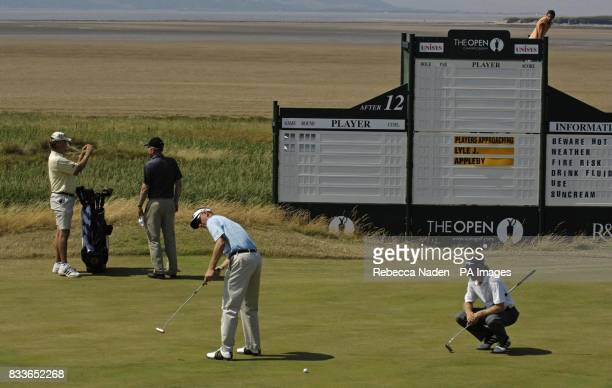 Australia's Wayne Perske is watched by Germany's Bernhard Langer during a practice session at Royal Liverpool Golf Club Hoylake