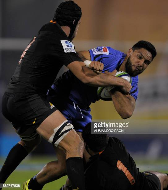 Australia's Western Force's centre Curtis Rona vies for the ball with Argentina's Jaguares lock Guido Petti and prop Santiago Garcia Botta during...