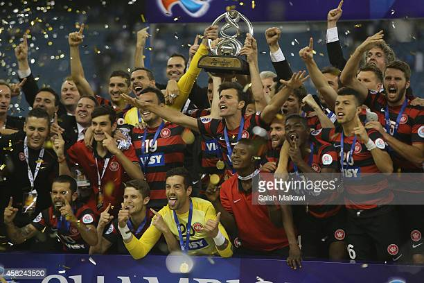 Australia's Western Sydney Wanderers celebrate after winning the second leg of the AFC Champions League 2014 football final with a 00 draw against...