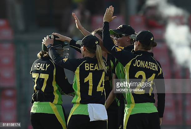 Australia's wicketkeeper Alyssa Healyis congratulated by teammates after taking a catch to dimiss England's Sarah Taylor during the World T20 women's...