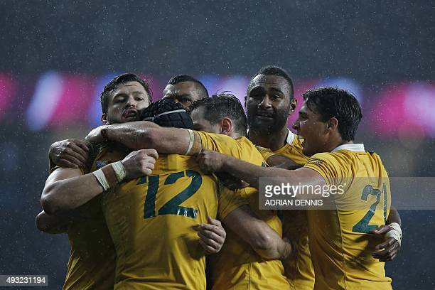 Australia's wing Adam AshleyCooper and Australia's centre Tevita Kuridrani celebrate with teammates after winning a quarter final match of the 2015...