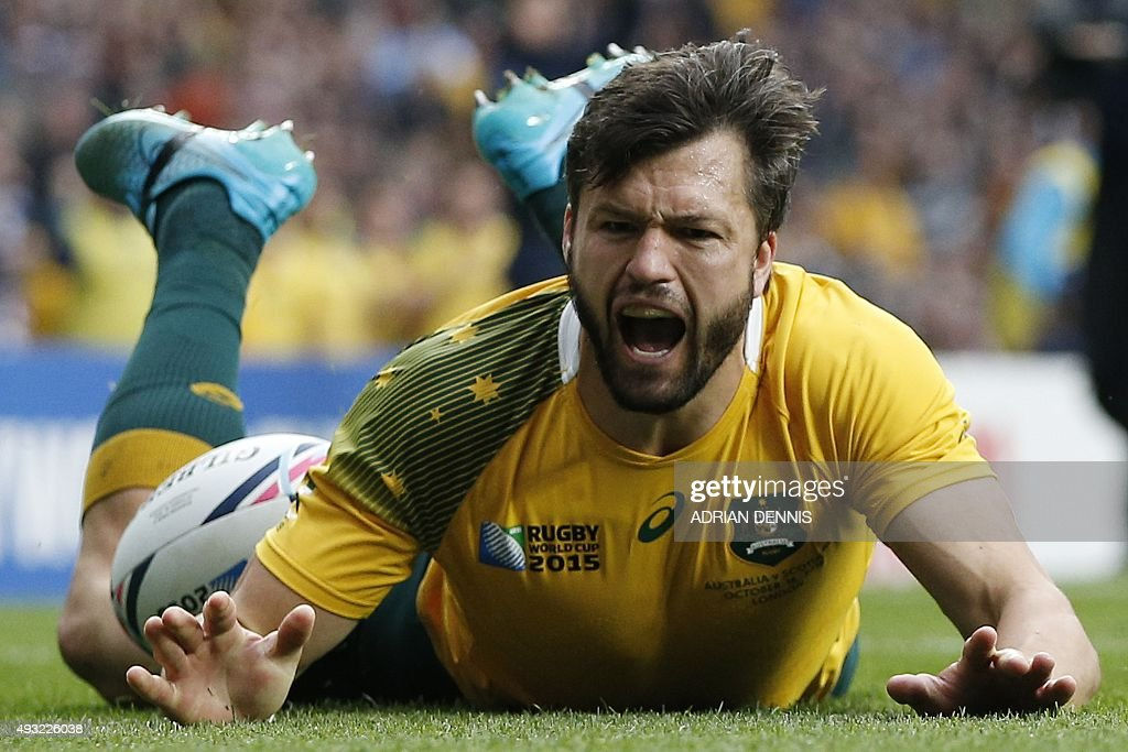 Australia's wing Adam AshleyCooper scores the first try during a quarter final match of the 2015 Rugby World Cup between Australia and Scotland at...