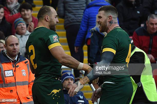 Australia's wing Blake Ferguson celebrates after scoring the team's first try with Australia's centre Josh Dugan during the rugby league Four Nations...