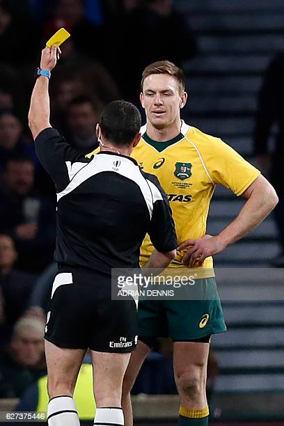 Australia's wing Dane HaylettPetty is shown a yellow card during the international rugby union test match between England and Australia at Twickenham...