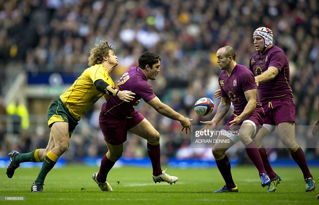 Australia's wing Nick Cummins (L) tackles England's centre Brad Barritt (2nd L) as he tries to hand the ball to England's wing Charlie Sharples (2nd R) during the International rugby union test match between England and Australia at Twickenham Stadium in south-west London, England, on November 17, 2012.