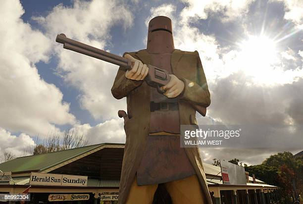 Australiatourismbigart BY NEIL SANDS A picture taken on May 26 shows a giant statue of Australian outlaw Ned Kelly at Glenrowan the location of his...