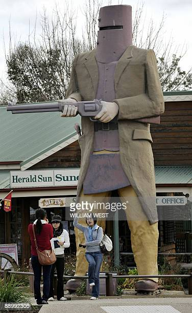 Australiatourismbigart BY NEIL SANDS In a picture taken on May 26 tourists pose in front of a giant statue of Australian outlaw Ned Kelly at...