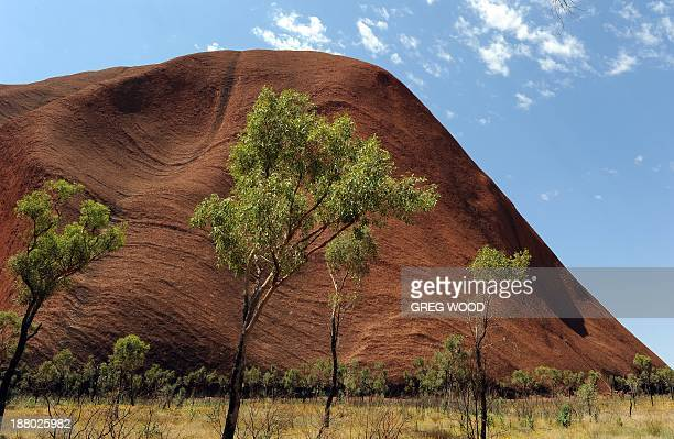 AustraliatourismindigenousUluruFEATURE by Madeleine Coorey This photo taken on October 11 2013 shows Uluru formerly known as Ayers Rock a large...