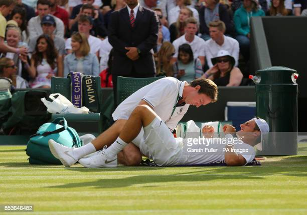 Australiua's Bernard Tomic received treatment in his match against Czech Republic's Tomas Berdych during day three of the Wimbledon Championships at...