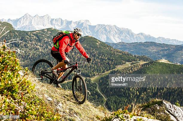 Austria, Altenmarkt-Zauchensee, young mountain biker driving at Low Tauern