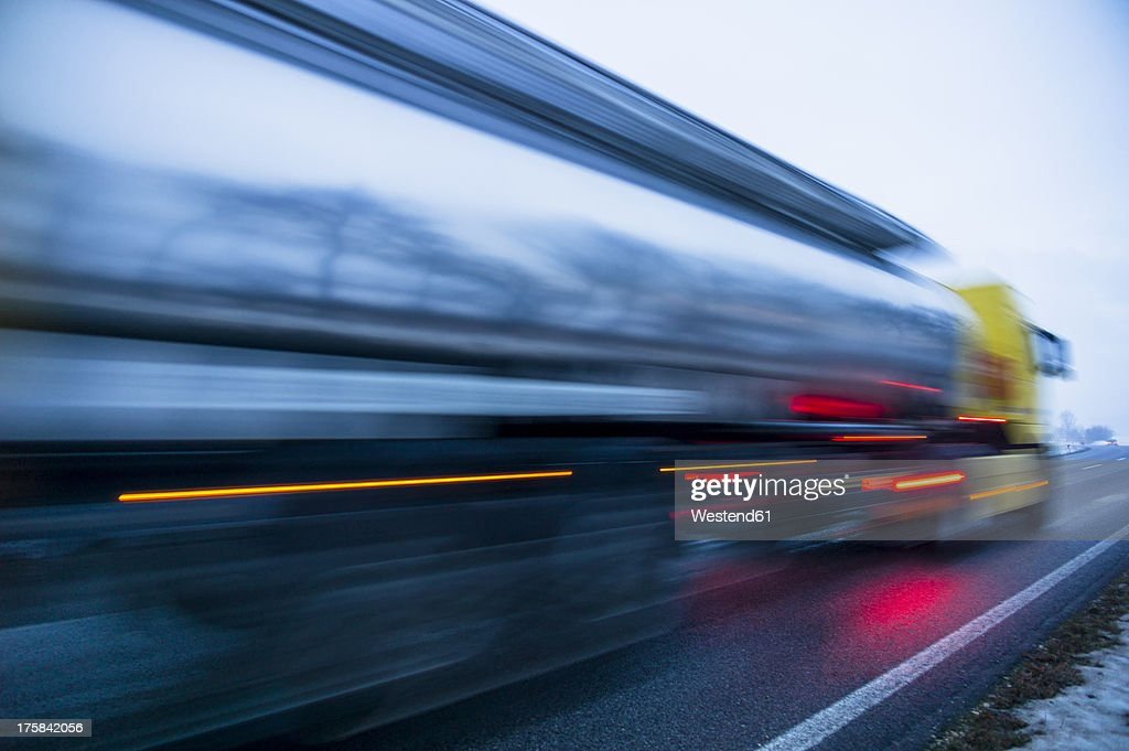 Austria, Cargo truck moving on country road in winter