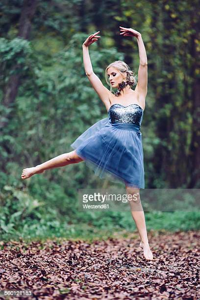 Austria, female dancer in the wood, jumping