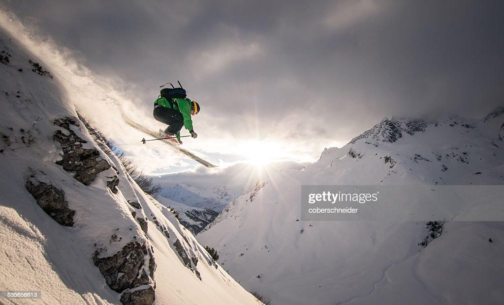 Austria, Freeride skier jumping off rock : Stock Photo