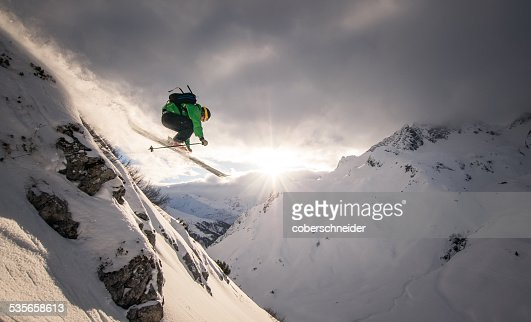 Austria, Freeride skier jumping off rock : Stock Photo