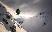 Austria, Freeride skier jumping off rock