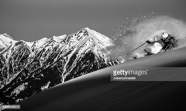 Austria, Front view of free ride skier downhill skiing