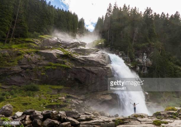 Austria, High Tauern National Park, woman at Krimml waterfalls