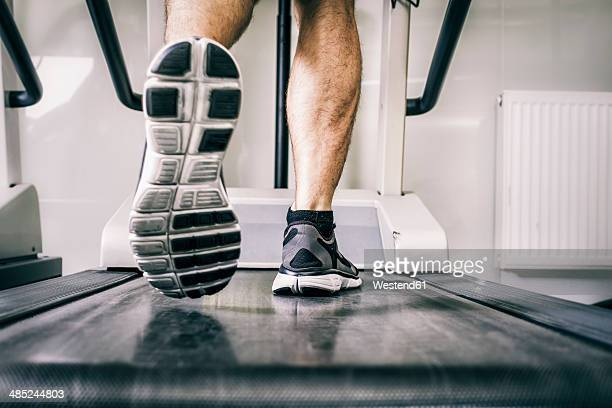 Austria, Klagenfurt, man running on treadmill