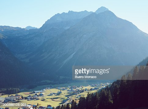 Austria, Kleinwalsertal, Hirschegg, village in mountainous landscape : Stock Photo