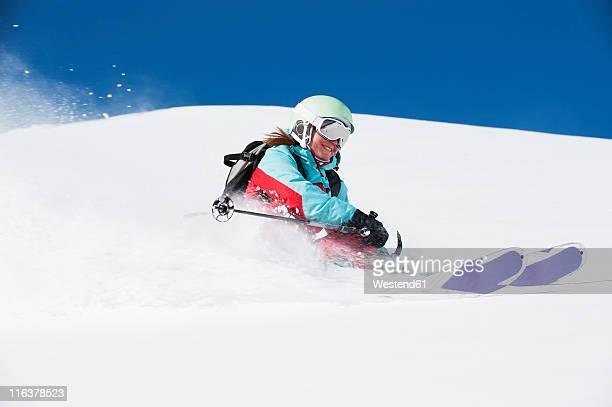 Austria, Kleinwalsertal, Woman skiing and smiling