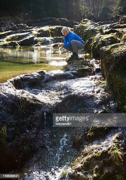 Austria, Land Salzburg, Faistenau, Mature woman hiking